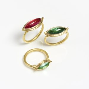 Three 18 carat gold rings with marquise shaped tourmalines with twist detail on the shoulders and granules.